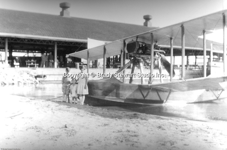 Presque Isle PA:  Stewart children standing in front of a mail delivery airplane - 1927. The plane was a Canadian Vickers seaplane used to deliver mail to islands along Lake Erie.