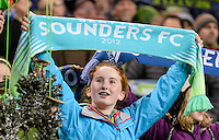 November, 2013: CenturyLink Field, Seattle, Washington: Seattle Sounders FC fan holds up a scarf  as the Portland Timbers defeat  the Seattle Sounders FC 2-1 in the Major League Soccer Playoffs semifinals Round.