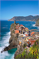 In the early afternoon - just a few hours after sunrise, the Cinque Terre is splashed with sunlight and the colors are vibrant. Looking over the village of Vernazza, you can see the Ligurian Sea. North, up the rocky coast, you can see the town of Monterosso al Mare.