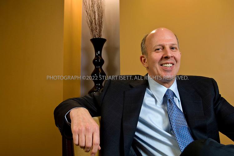 3/19/2006--Bellevue, WA, USA..Lennox Scott, CEO of John L. Scott real Estate in Washington State, posing in the companies office in Bellevue, Washington...Photograph ©2007 Stuart Isett.All rights reserved