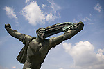 A statue of a man charging at the Statue Park near Budapest. The communist era Statue Park outside of Budapest has many statues that come from the old communist era in Hungary.