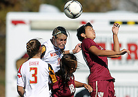 COLLEGE PARK, MD - OCTOBER 21, 2012:  Olivia Wagner (11) of the University of Maryland up for a header with Nora Kervroedan (20) of Florida State during an ACC women's match at Ludwig Field in College Park, MD. on October 21. Florida won 1-0.