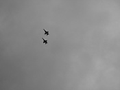 American military jet planes fly in formation above the beach in Guam, on Saturday, Mar. 10, 2007.  Sometimes known as 'America in Asia', Guam is a popular destination for Japanese tourists ( accounting for approx 90% of the island's visitors) with average visitor numbers from Japan approaching 1million.  The island, a 3.5 hour flight from Japan, has more than 20 large hotels and numerous duty-free shopping malls catering to the Japanese tourists predilection for designer brand name goods, as well as golfing and other water based entertainment features. In 2007-2008 US military personal currently stationed in the Japanese Okinawan Islands will relocate their bases and operations  to Guam, helping to stabilise the island's economy which suffered after tourism decreased in recent years due to a  fear of flying by Japanese post 9-11 World Trade Centre disaster, a 2003 typhoon and the SARS disease outbreak in Asia.
