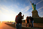 Colombian Tourist  poses for a picture at the Statue of Liberty  in New York, United States. 9/01/2012. Officials announced the arrival of the record-breaking 50 millionth visitor of the year. Photo by Kena Betancur / VIEWpress.