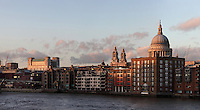 St Paul's Cathedral, London, UK, 1675-1710, by architect Sir Christopher Wren, seen from the River Thames. The 111 metre high dome and twin towers peep over the surrounding modern buildings. Picture by Manuel Cohen