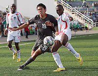 Victor Chavez battles for the ball against Francis Mulimbika. US Men's National Team Under 17 defeated Malawi 1-0 in the second game of the FIFA 2009 Under-17 World Cup at Sani Abacha Stadium in Kano, Nigeria on October 29, 2009.
