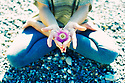 Coastal flower in a yoga hand mudra.