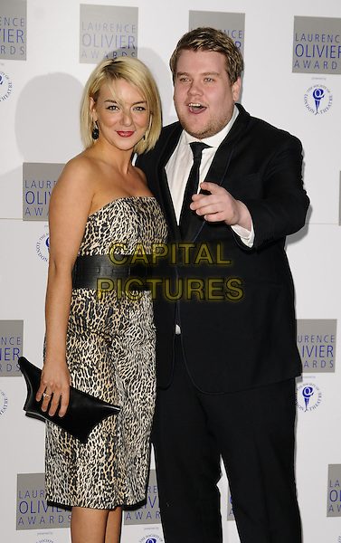 SHERIDAN SMITH & JAMES CORDEN .Laurence Olivier Awards at the Grosvenor House Hotel, Park Lane, London, England..March 8th 2009.half 3/4 length strapless leopard print black suit tie dress clutch bag couple hand mouth open pointing .CAP/CAN.©Can Nguyen/Capital Pictures.