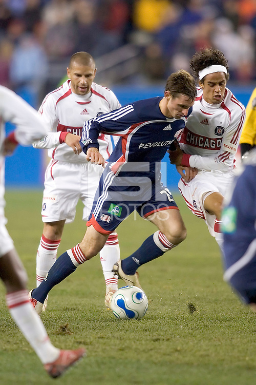 Andy Dorman (NE Revolution, blue) dribbles in traffic. NE Revolution advance to Eastern Conference Finals with a 4-2  penalty kicks victory over Chicago Fire after a 2-2 aggregate tie, at Gillette Stadium.
