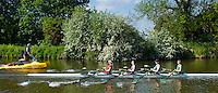 Coach trains oarsmen rowing skiff on the River Thames in Berkshire, UK