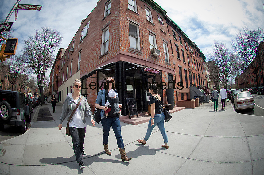 Pedestrians pass The Pink Tea Cup restaurant, recently relocated from Greenwich Village, in the Fort Greene neighborhood of Brooklyn in New York on Saturday, April 12, 2014. (© FrancesM. Roberts)