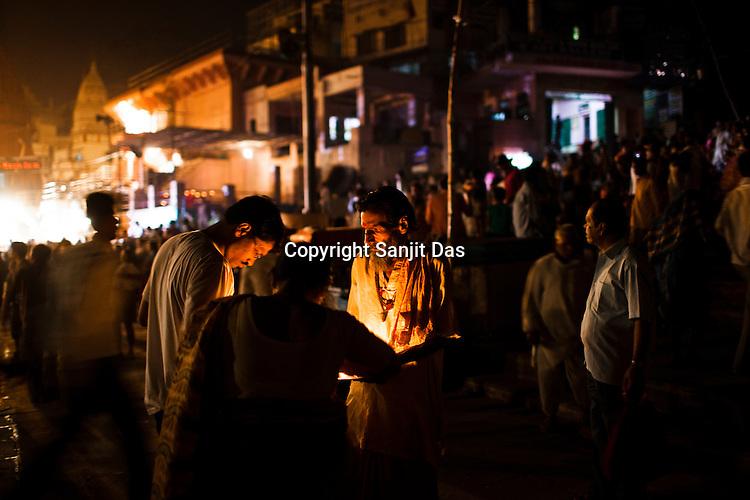 Hindu pilgrims take blessings from a priest at the Dashashwamedh Ghat in the ancient city of Varanasi in Uttar Pradesh, India. Photograph: Sanjit Das/Panos