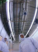 Technicians inspecting progress on ventilation for electronics 'clean' room. Arizona.