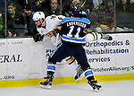 2 December 2011: University of Vermont Catamount forward Colin Markison, a Freshman from Princeton, NJ, is checked into the boards by University of Maine Black Bear forward Theo Andersson, a Senior from Gothenburg, Sweden, at Gutterson Fieldhouse in Burlington, Vermont. The Catamounts fell to the Black Bears 6-4 in the first game of their 2-game Hockey East weekend series. Mandatory Credit: Ed Wolfstein Photo