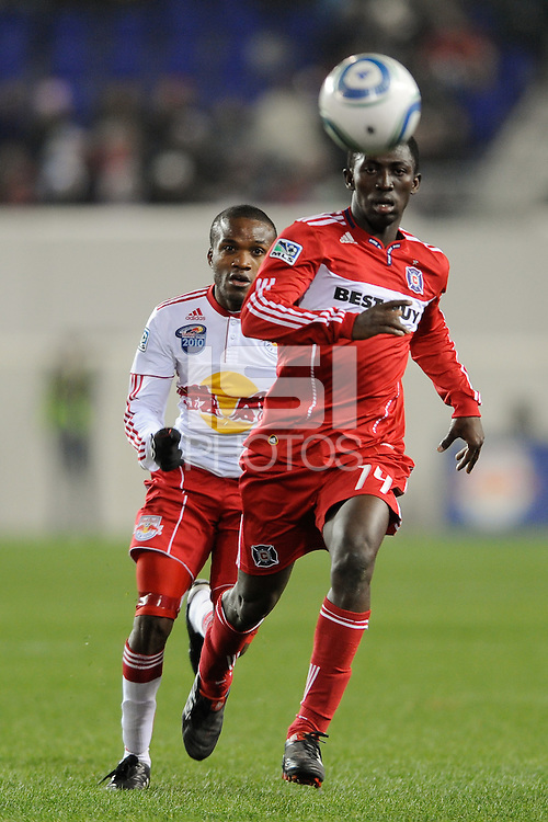 Patrick Nyarko (14) of the Chicago Fire is chased by Dane Richards (19) of the New York Red Bulls during the first half of a Major League Soccer match between the New York Red Bulls and the Chicago Fire at Red Bull Arena in Harrison, NJ, on March 27, 2010. The Red Bulls defeated the Fire 1-0.