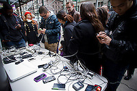 A 7-Eleven store set up charging stations outside it's store for people to charge their cell phones in midtown in New York on Wednesday, October 31, 2012. Con Edison is estimating electricity will not be restored back to Lower Manhattan for several more days and a number of businesses are allowing people to charge their batteries.  (© Frances M. Roberts)