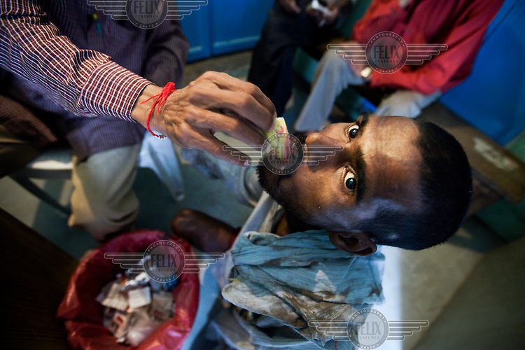 An addict is given a dose of methadone at the Sharan Centre in Delhi's Old City, a drop-in centre for Intravenous Drug Users who live on the streets. It sees around 200 people a day, providing them with food, substitute drugs, clean needles, basic medical help and counselling. .