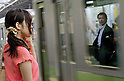 Tokyo, Japan - People wait for the train at Shinjuku Station. Morning commuters typically spend over one hour on the train going to work. Trains are usually so packed that train platform staff have to push commuters to fit in the train so that the doors can close shut. (Photo by Yumeto Yamazaki/AFLO)