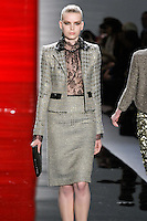 Marleen walks runway in a steel cropped metallic herringbone jacket with jeweled detail and metallic herringbone pencil skirt, from the Reem Acra Fall 2012 Feminine Power collection fashion show, during Mercedes-Benz Fashion Week New York Fall 2012 at Lincoln Center.