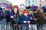 Cadbury's elf Rachel Davidson with Jennifer O Mahony and Shane O'Sullivan at the  Fun  Event when the Cadbury's Chocolate Truck came to the Square Tralee on Saturday