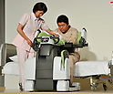 November 1, 2011, Tokyo, Japan - An intelligent machine with padded arms capable of helping health care workers lift disabled patients from their beds as Toyota unveiled experimental robots for nursing and healthcare aimed for commercialization from 2013 to the media at its facility in Tokyo on Tuesday, November 1, 2011. (Photo by Natsuki Sakai/AFLO) [3615] -mis-