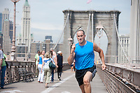 Man running on the Brooklyn Bridge