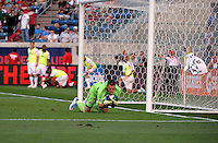 Toronto goalkeeper Milos Kocic (30) makes a save.  The Chicago Fire defeated Toronto FC 2-0 at Toyota Park in Bridgeview, IL on August 21, 2011.