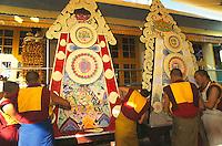 Monks at Nambyal monastery, sculpting butter tormas during Losar, Tibetan New Year.