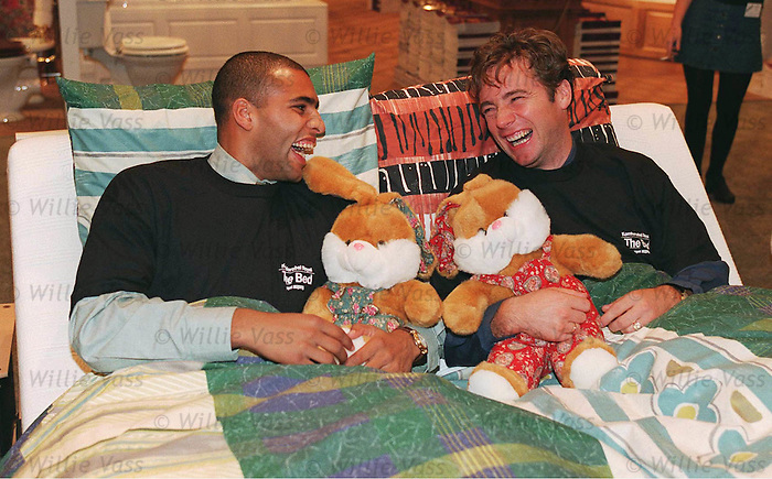Ally McCoist and Pierre Van Hooijdonk team up in bed together at the launch of the Modern Homes Exhibition at the SECC November 1995