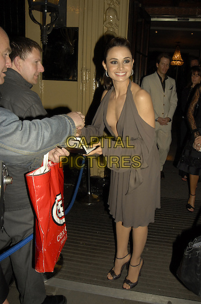 "MIA MAESTRO.Leaving the After Party following the .UK Film Premiere of ""Poseidon"",.The Waldorf, London, .England, May 28th 2006..full length grey dress signing autograph.Ref: SW.www.capitalpictures.com.sales@capitalpictures.com.©Stephen Walters/Capital Pictures."