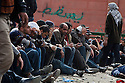 """Egyptian anti-Mubarak protesters sits idle along their defensive border during a large demonstration dubbed the """"Day of Departure"""" February 04, 2011 in Tahrir Square in Cairo, Egypt. The Egyptian military created a buffer zone between anti and pro Mubarak factions of protesters were able to prevent large scale clashes between the two sides that had taken place the past several days. ."""