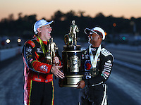 Nov 13, 2016; Pomona, CA, USA; NHRA top fuel driver Doug Kalitta (left) poses for a portrait with his trophy for winning the Auto Club Finals alongside Antron Brown with his trophy for winning the world championship at Auto Club Raceway at Pomona. Mandatory Credit: Mark J. Rebilas-USA TODAY Sports