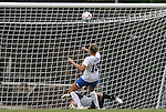 28 August 2009: Duke's KayAnne Gummersall (13) puts the ball in the roof of the goal. The Duke University Blue Devils lost 3-2 to the University of Central Florida Knights at Fetzer Field in Chapel Hill, North Carolina in an NCAA Division I Women's college soccer game.