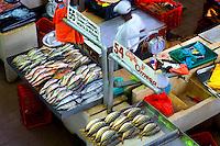 Fish vendor at the fish market in panama city panama for Fish market panama city beach