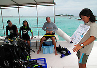 November 29th, 2008_MALDIVES_ A dive leader briefs a group of divers from the Full Moon resort in the Maldives.  Photographer: Daniel J. Groshong/Tayo Photo Group