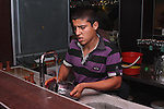 Amjd Salah, 19, from Diyala, works at the Amsterdam Cafe on Salm Street.