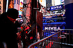 A man works to get set up lights in Times Square for New Year Eve 2012 celebrations in New York City. 12/29/11.  Photo by Eduardo Munoz Alvarez / VIEWpress.