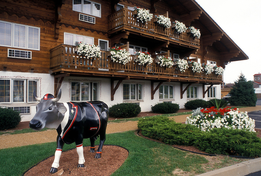 """New Glarus, WI, Wisconsin, """"Little Switzerland"""", Painted swiss cow outside The Chalet Landhaus Inn in the town of New Glarus."""