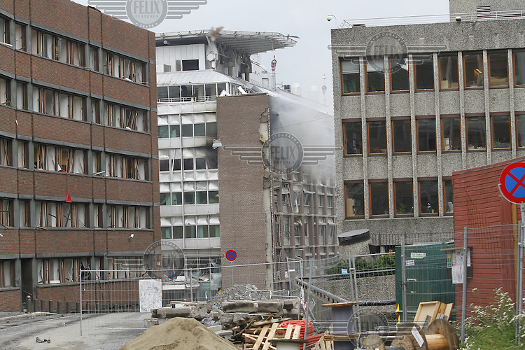 (July22,2010) Smoke billows from a government building after a large vehicle bomb was detonated near the offices of Norwegian Prime Minister Jens Stoltenberg on 22 July 2011. Although Stoltenberg was reportedly unharmed the blast resulted in several injuries and deaths. <br /> Another terrorist attack took place shortly afterwards, where a man killed over 80 children and youths attending a political camp at Ut&oslash;ya island. <br /> Anders Behring Breivik was arrested on the island and has admitted to carrying out both attacks.<br /> (photo:Fredrik Naumann/Felix Features)