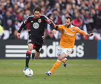 Branko Boskovic (8) of D.C. United fights for the ball with Brad Davis (11) of Houston Dynamo during the game at RFK Stadium in Washington,DC. D.C. United tied the Houston Dynamo, 1-1.  With the tie, Houston won the Eastern Conference and advanced to the MLS Cup.