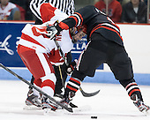 Danny O'Regan (BU - 10), Garrett Vermeersch (NU - 9) - The visiting Northeastern University Huskies defeated the Boston University Terriers 6-5 on Friday, January 18, 2013, at Agganis Arena in Boston, Massachusetts.