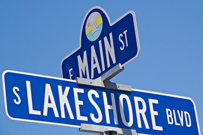 Road sign for intersection of Main Street and Lakeshore Boulevard in downtown Marquette Michigan.