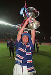 Ally McCoist lifts the Coca-Cola league cup at Celtic Park after beating Hearts in the final