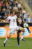 Jared Jeffrey (25) of D. C. United and Amobi Okugo (14) of the Philadelphia Union. The Philadelphia Union defeated D. C. United 2-0 during a Major League Soccer (MLS) match at PPL Park in Chester, PA, on August 10, 2013.