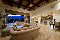 (Multiple values), Mediterranean decore family room featuring coffered ceilings, elegant furnishings and posketed doors that open to the outside