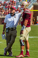 TALLAHASSEE, FLA 9/10/16-Florida State Head Coach Head Coach Jimbo Fisher talks with quarterback Sean Maguire during a break against Charleston Southern, Saturday at Doak Campbell Stadium in Tallahassee. <br /> COLIN HACKLEY PHOTO