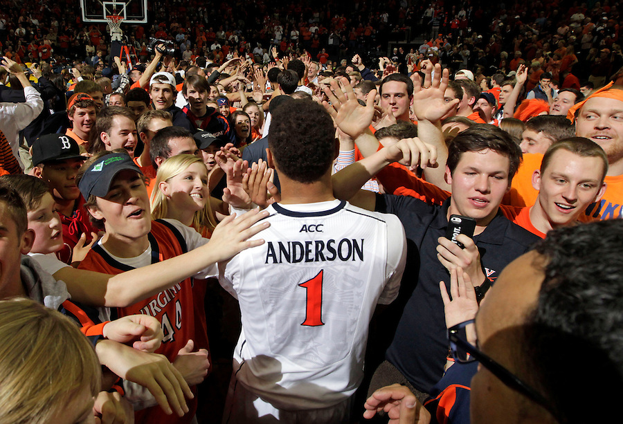 Virginia guard Justin Anderson (1) is surrounded by fans after defeating Syracuse 75-56 in an NCAA basketball game Saturday March 1, 2014 in Charlottesville, VA.