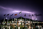 June 22, 2010; Omaha, NE, USA; Lightning illuminates the sky over Rosenblatt Stadium as game 8 of the 2010 College World Series featuring the Oklahoma Sooners and the Clemson Tigers is postponed due to rain and lightning. Mandatory Credit: Crystal LoGiudice-US PRESSWIRE.