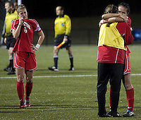 November 12, 2010 - Newton, MA - Boston University women's soccer players Corie Halasz (left) reacts as Lina Cords (right) hugs and unidentified teammate after BU's first round lose to Boston College in the NCAA tournament.