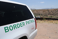Nogales, Arizona - A Border Patrol vehicle parked near the international U.S.-Mexico border. The vehicle wes part of a caravan that took journalists to the border in an event sponsored by the U.S. Customs and Border Protection agency. This area is near the Border Patrol Nogales station, one of eight in the Tucson Sector, which is the busiest on the U.S.-Mexico border for illegal immigration, drug smuggling and border deaths. Photo by Eduardo © 2012